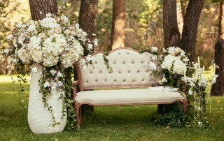 luxury wedding decorations with bench, candle and flowers compisition on ceremony place