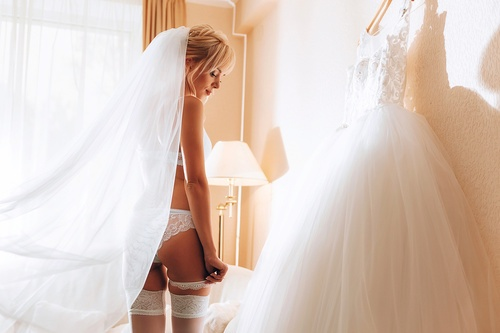 morning of the bride. bride in luxurious underwear in anticipati